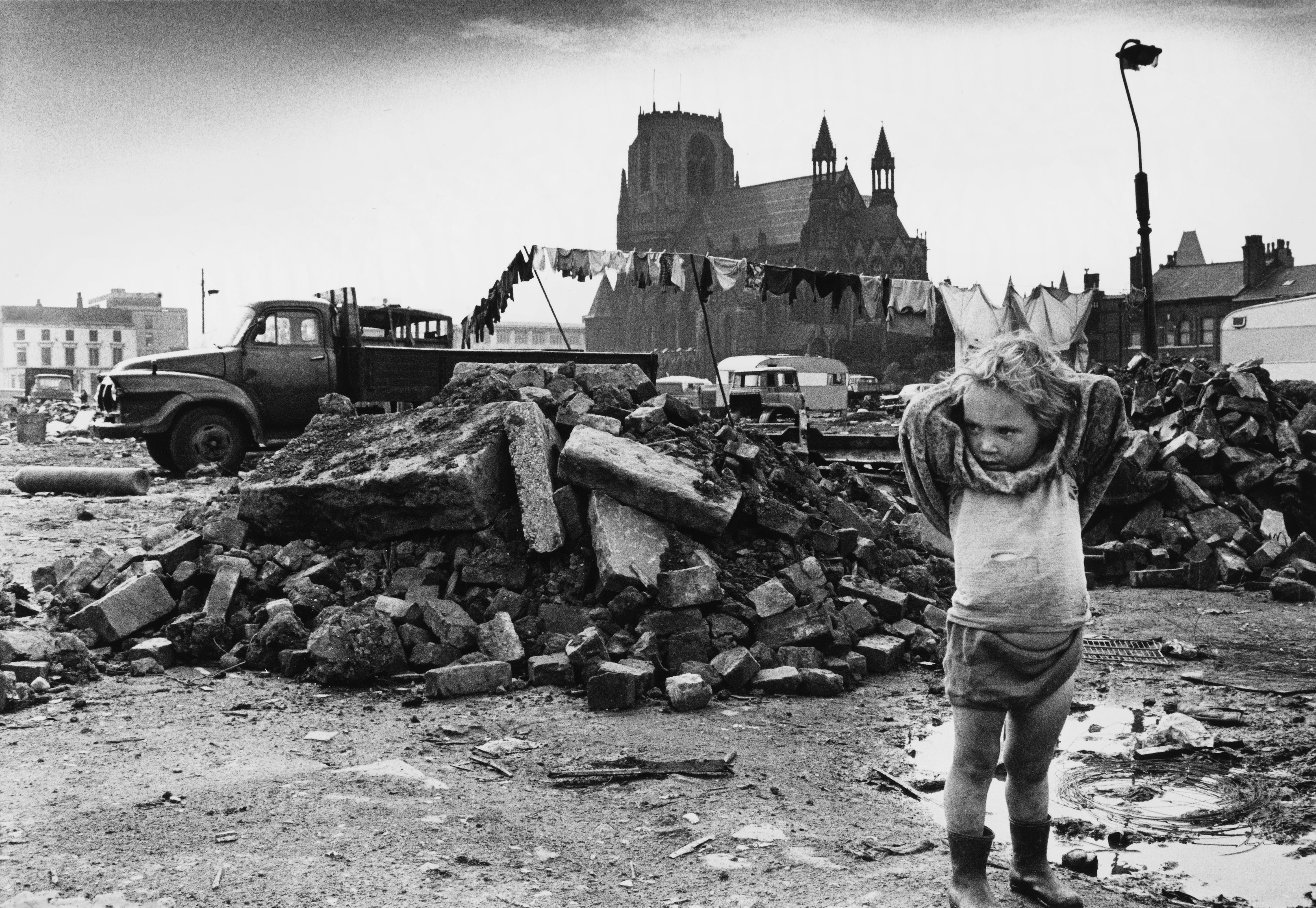 Young Traveller Amid Rubble   Manchester 1968
